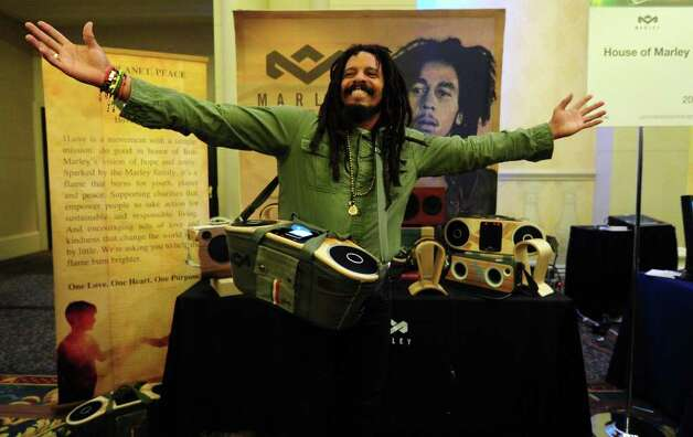 Rohan Marley, the son of late Reggae artist Bob Marley and Janet Hunt, gestures while singing along to his father's timeless music while displaying the Bag of Rythym portable audio system from The House of Marley which plays music from any MP3 player at CES Unveiled, ahead of the opening of the annual Consumer Electronics Show on January 8, 2012 in Las Vegas, Nevada.  AFP PHOTO / Frederic J. BROWN Photo: FREDERIC J. BROWN, AFP/Getty Images / 2012 AFP