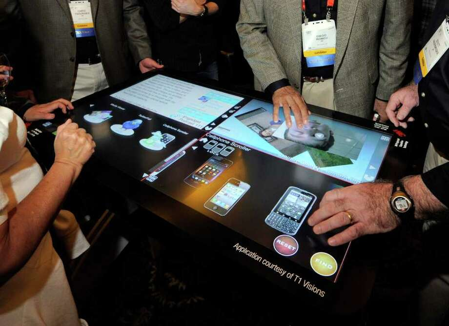 LAS VEGAS, NV - JANUARY 08:  Attendees try a prototype 3M Touch Systems 46-inch, projected capacitive display during a press event at The Venetian for the 2012 International Consumer Electronics Show (CES) January 8, 2012 in Las Vegas, Nevada. The display utilizing technology from T1 Visions features a six-millisecond response to touch time, handles up to 20 finger touches at once and rejects accidental palm touches. CES, the world's largest annual consumer technology trade show, runs from January 10-13 and is expected to feature 2,700 exhibitors showing off their latest products and services to about 140,000 attendees. Photo: Ethan Miller, Getty Images / 2012 Getty Images