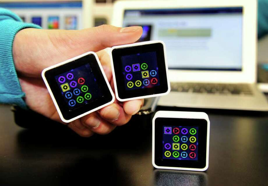 Sifteo wireless game cubes are displayed at the 2011 International Consumer Electronics Show January 8, 2011 in Las Vegas, Nevada.  Sifteo cubes are digital interactive tiles or blocks with full-color screens that respond to motion and to each other wirelessly.  CES, the world's largest annual consumer technology tradeshow runs through January 9 and is expected to feature 2,700 exhibitors showing off their latest products and services to about 126,000 attendees.     AFP PHOTO / Robyn Beck Photo: ROBYN BECK, AFP/Getty Images / 2011 AFP