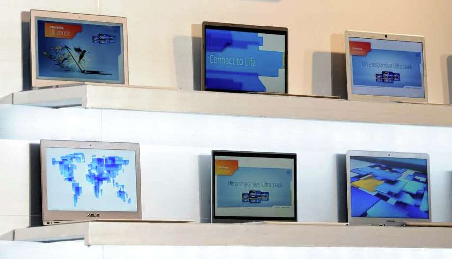 LAS VEGAS, NV - JANUARY 09:  Ultrabooks are displayed during a press event by Intel Corp. at The Venetian for the 2012 International Consumer Electronics Show January 9, 2012 in Las Vegas, Nevada. CES, the world's largest annual consumer technology trade show, runs from January 10-13 and is expected to feature 2,700 exhibitors showing off their latest products and services to about 140,000 attendees. Photo: Ethan Miller, Getty Images / 2012 Getty Images