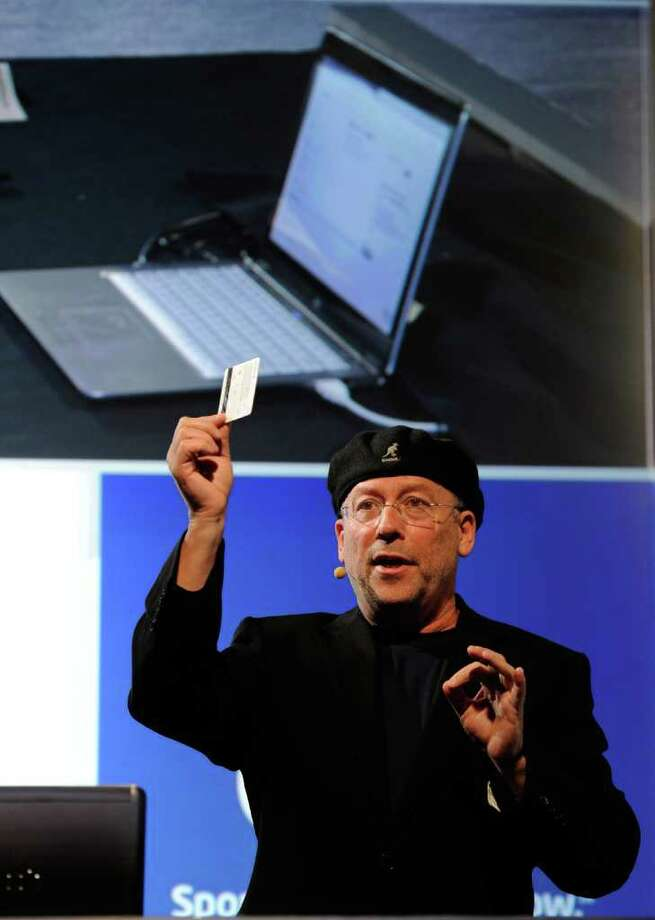 "LAS VEGAS, NV - JANUARY 09:  Intel Corp. Corporate Vice President and General Manager of the PC Client Group Shmuel ""Mooly"" Eden demonstrates an Ultrabook with technology that recognizes the user's credit card that can be tapped on the keyboard to make purchases during a press event at The Venetian for the 2012 International Consumer Electronics Show January 9, 2012 in Las Vegas, Nevada. CES, the world's largest annual consumer technology trade show, runs from January 10-13 and is expected to feature 2,700 exhibitors showing off their latest products and services to about 140,000 attendees. Photo: Ethan Miller, Getty Images / 2012 Getty Images"