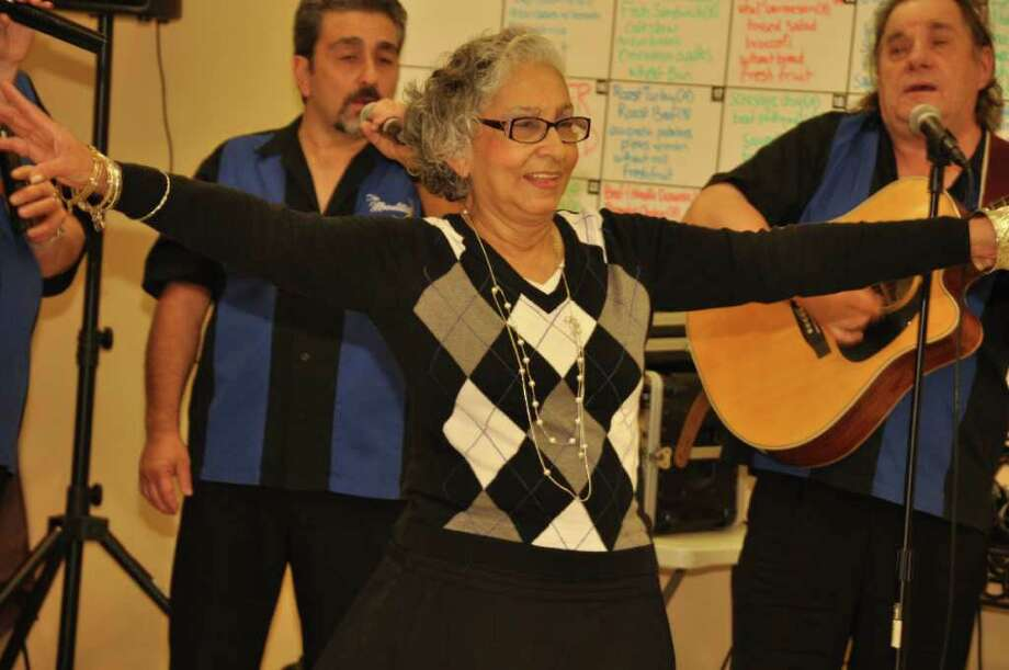 Camilla Watts, 75, who suffered three strokes last March, dances nonstop to the Doo-Wop sounds of the Moonlites at the Culebra Senior Center. Watts is under doctors orders to do more dancing to recover from her strokes, and she readily complied. Courtesy photo Photo: Courtesy Photo
