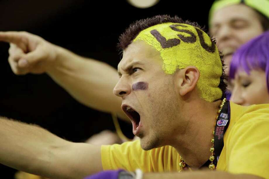LSU fans are seen before the BCS National Championship college football game between the Alabama and LSU, Monday, Jan. 9, 2012, in New Orleans.  (AP Photo/David J. Phillip) Photo: David J. Phillip, Associated Press / AP