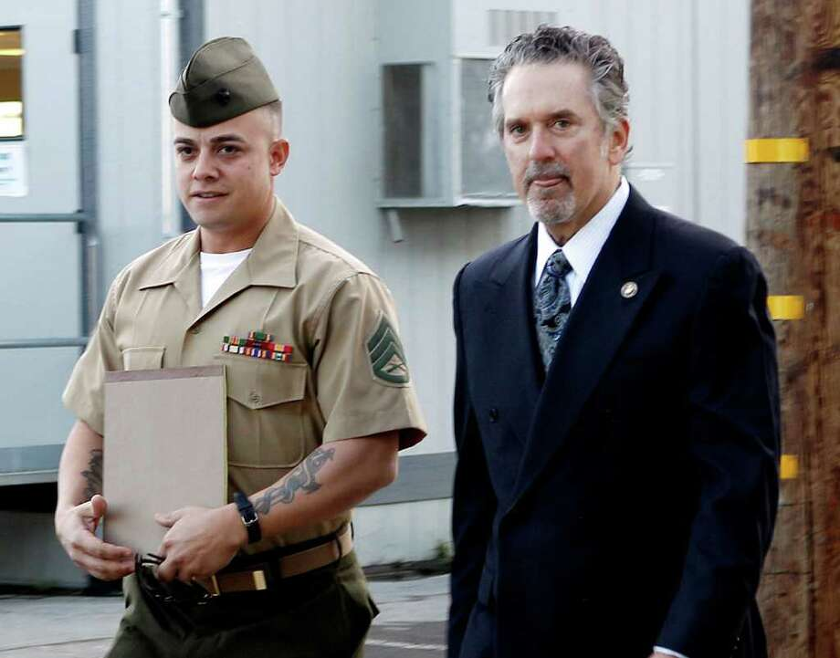FILE - In this Jan. 5, 2012 file photo, United States Marine Staff Sgt. Frank Wuterich arrives at a court room at Camp Pendleton with lead defense attorney Neal Puckett in Camp Pendeton, Calif. Opening arguments in Wuterich's will be Monday, Jan. 9, 2012 _ more than six years after his Marine squad in 2005 killed 24 Iraqis, including unarmed women and children in the town of Haditha. (AP Photo/Lenny Ignelzi, File) Photo: Lenny Ignelzi / AP
