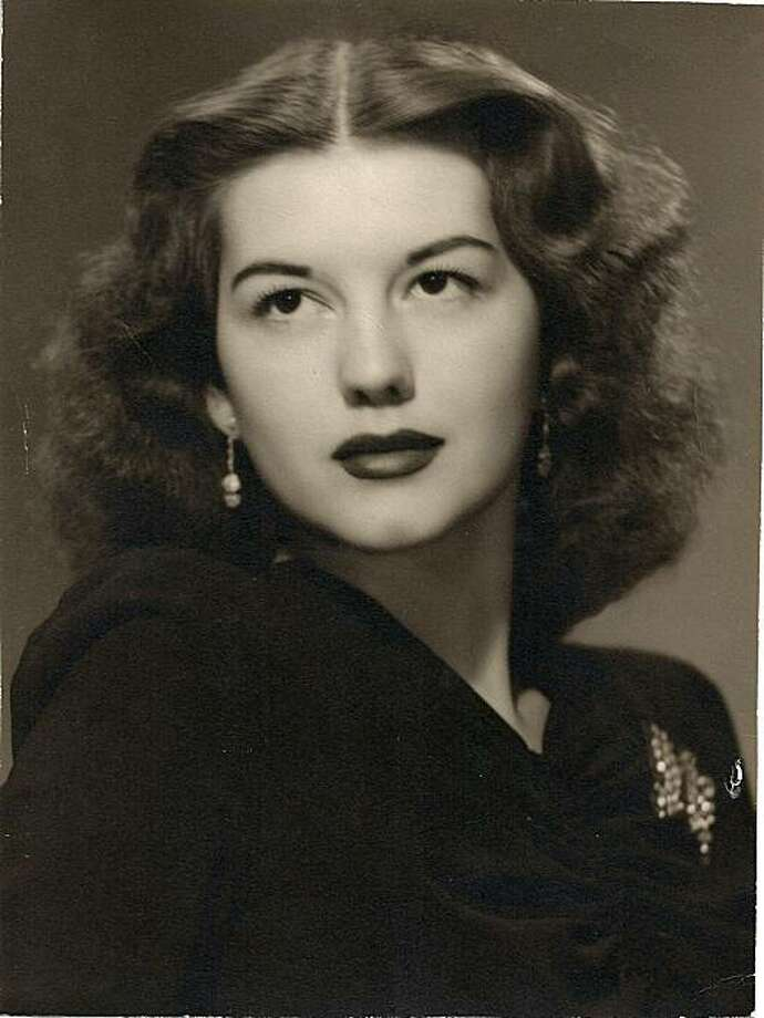 """This image released by the family of Geraldine Doyle, shows Doyle in 1942 at the age of 17. Geraldine Doyle was a Michigan factory worker used as the unwitting model for the World War II """"Rosie the Riveter"""" poster whose inspirational """"We Can Do It!"""" message became an icon of the feminist movement. Doyle died December 26, 2010, a spokesman for the Hospice House of Mid-Michigan told AFP. She was 86. Doyle didn't realize she had a famous face until she was flipping through a magazine in 1982 and spotted a reproduction of the poster, her daughter told The New York Times.    = RESTRICTED TO EDITORIAL USE = NOT FOR SALE FOR MARKETING OR ADVERTISING CAMPAIGN = (Photo credit should read -/AFP/Getty Images) Photo: -, AFP/Getty Images"""