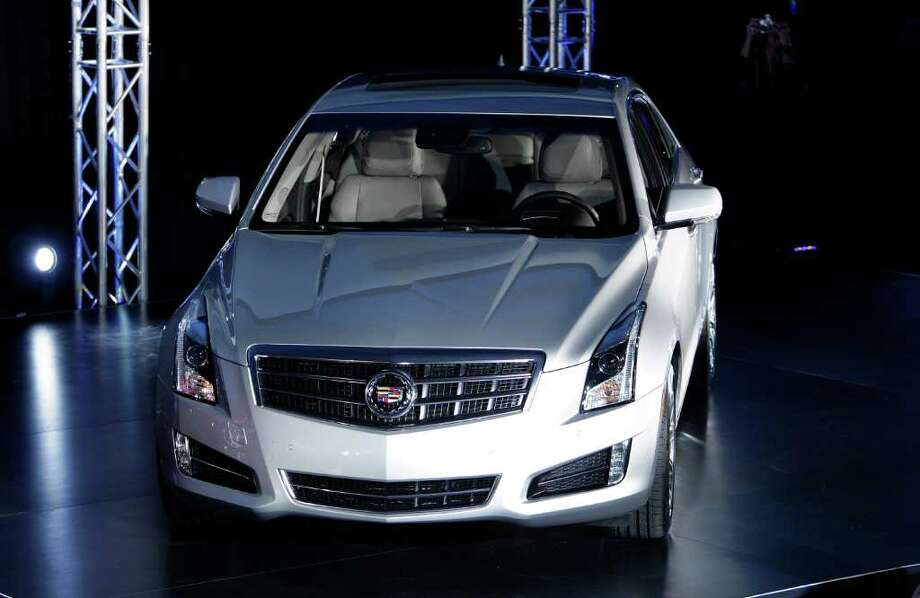 The 2013 Cadillac ATS makes its debut prior to the North American International Auto Show in Detroit, Sunday, Jan. 8, 2012. (AP Photo/Paul Sancya) Photo: Paul Sancya / AP