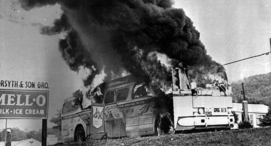 "This is a May 1961 file photograph of a Freedom Rider bus that went up in flames when a fire bomb was tossed through a window near Anniston, Ala. Filmmaker Stanley Nelson says December 2010, his new documentary ""Freedom Riders,"" is about the courageous activists who defiantly opposed the 1960s segregation of the South and hopes it may help inspire a new generation of youth. Photo: AP"