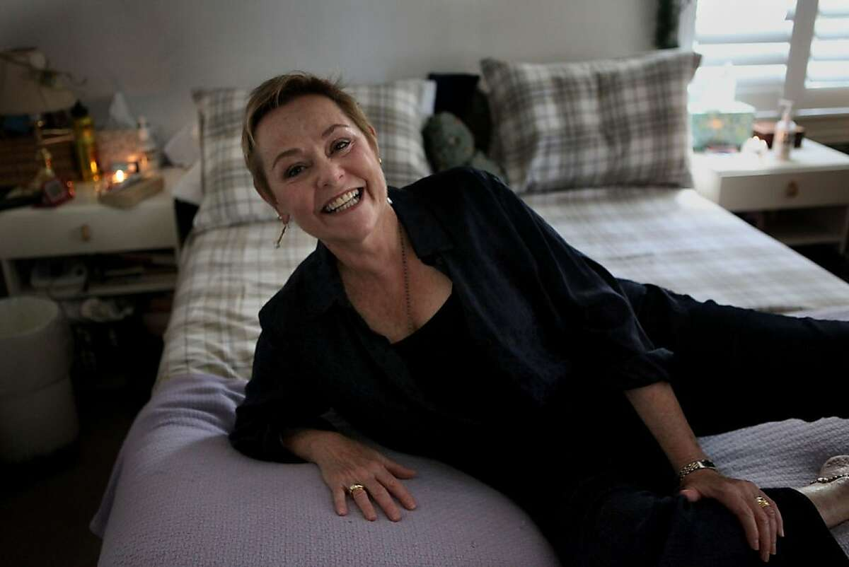 Cheryl Cohen Greene has made a living as a surrogate partner and is on her bed at her home office in Berkeley, Calif., on Tuesday, May 10, 2011. A surrogate partner for over 37 years, licensed therapists refer her to men who have problems with sexual intimacy. She often uses candles and music while working.