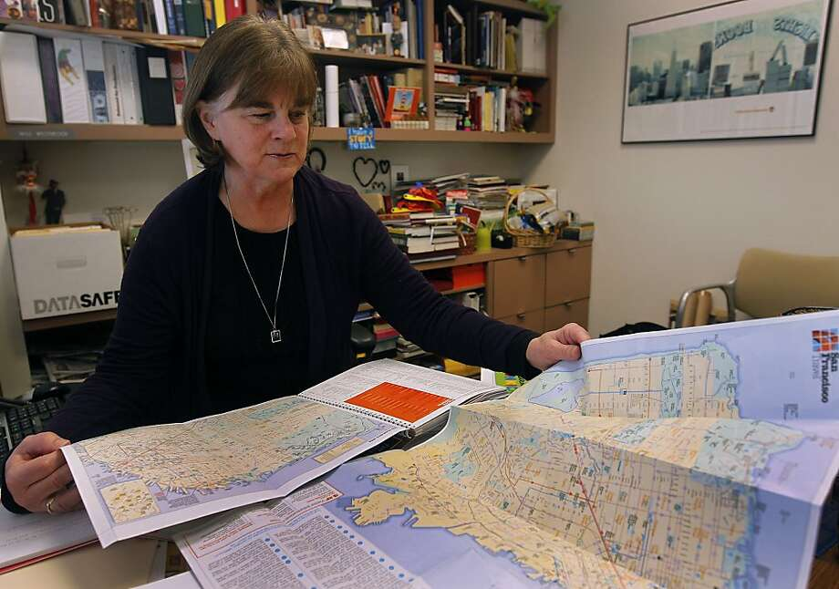 Cindy Westbrook Hu, director of editorial services for the San Francisco Travel Association, reviews maps of the city in San Francisco, Calif. on Thursday, Jan. 5, 2012. Photo: Paul Chinn, The Chronicle