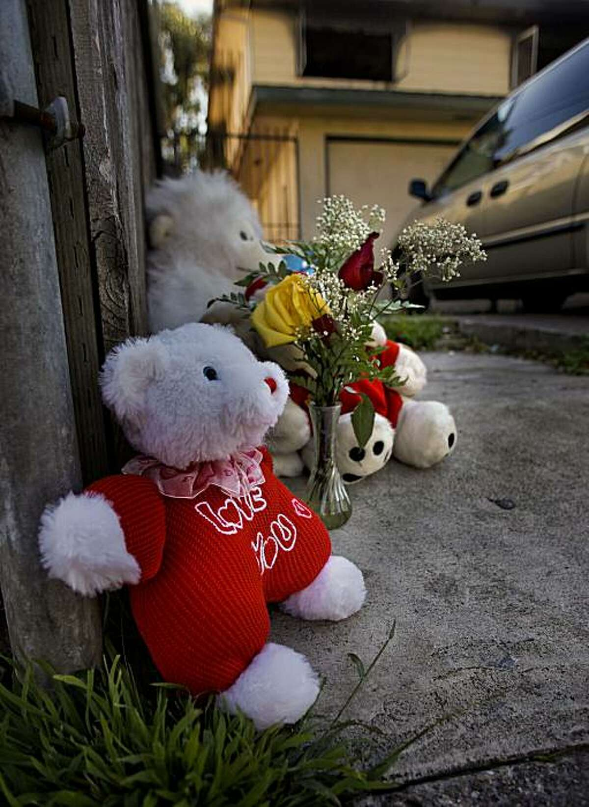 A small memorial continues to grow in front of the apartment building, the scene of an early morning fire at 1756 82nd Avenue, on Thursday Dec. 30, 2010, that claimed the lives of three people in East Oakland, Ca.