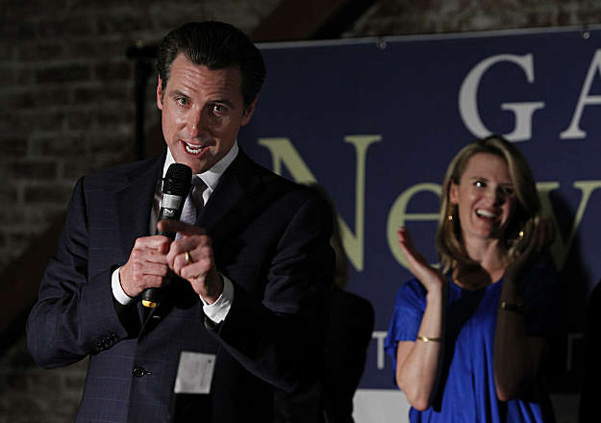 Mayor Gavin Newsom, Democratic candidate for lieutenant governor, thanks his supporters at an election night rally while his wife Jennifer looks on in San Francisco, Calif., on Tuesday, Nov. 2, 2010.