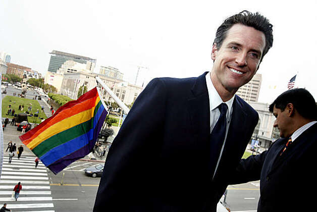 In the official 2008 Pride Flag Raising, Mayor Gavin Newsom raises the rainbow flag from the balcony of City Hall in San Francisco, Calif.  on Thursday,  June 26, 2008. Photo by Katy Raddatz / The Chronicle Photo: Katy Raddatz, The Chronicle