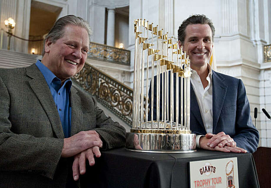 San Francisco Mayor Gavin Newsom and Arlington Mayor Robert Cluck, from right, pose with the Commissioner's Trophy at a press conference announcing the start of the trophy tour at San Francisco City Hall on Wednesday, Dec. 15, 2010. The tour will begin on Jan. 4, 2011. (Adam Lau/Special to The Chronicle) Photo: Adam Lau, Special To The Chronicle