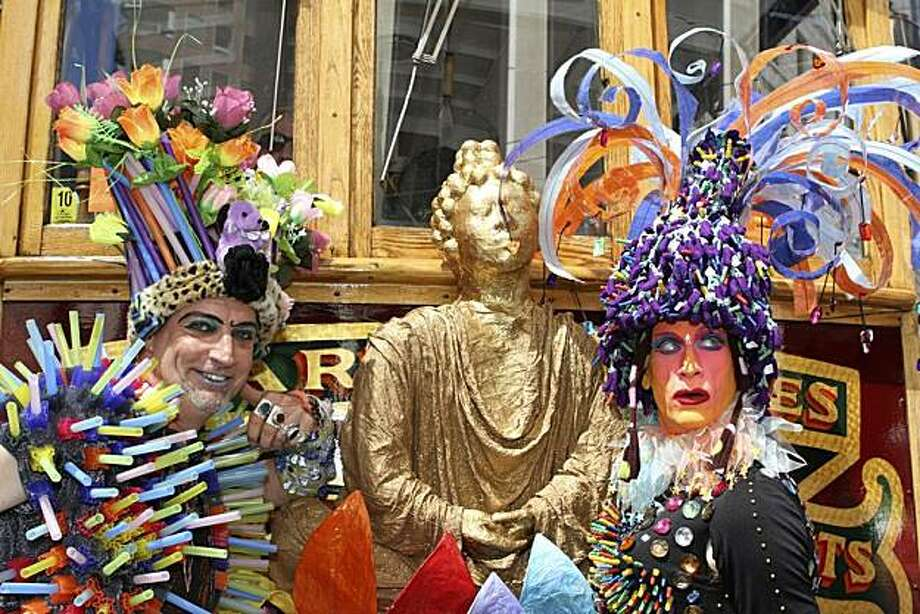 Tina and Vera follow a cable car decked out in their colorful headresses at the 40th annual Pride Parade in San Francisco. Photo: Rubyscooby, Reader Photo