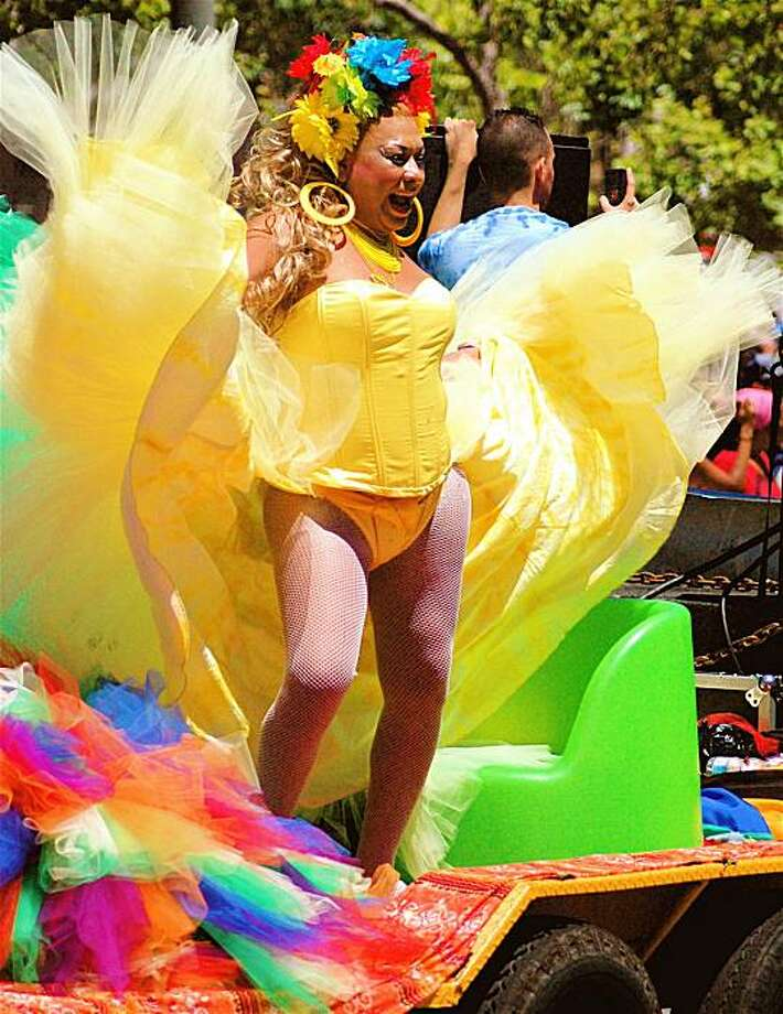 Many of the floats at the Gay Pride parade feature loud music and brightly-costumed dancing for the enjoyment of thousands of onlookers. Photo: Rsjaeger, Reader Photo