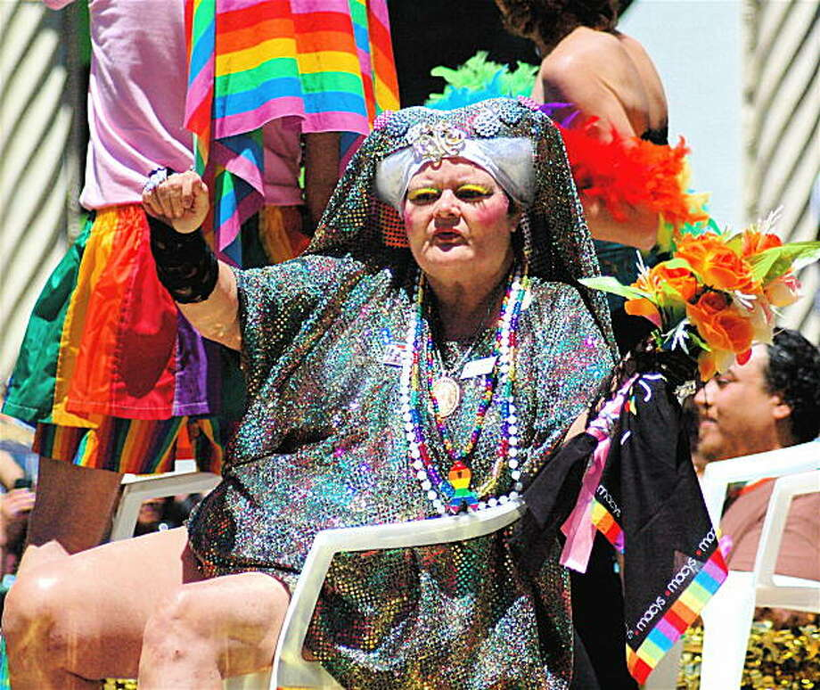 Participants in pride go all out in costume, like this reveler dressed in sequins from head to toe (or head to thigh). Photo: Rsjaeger, Reader Photo