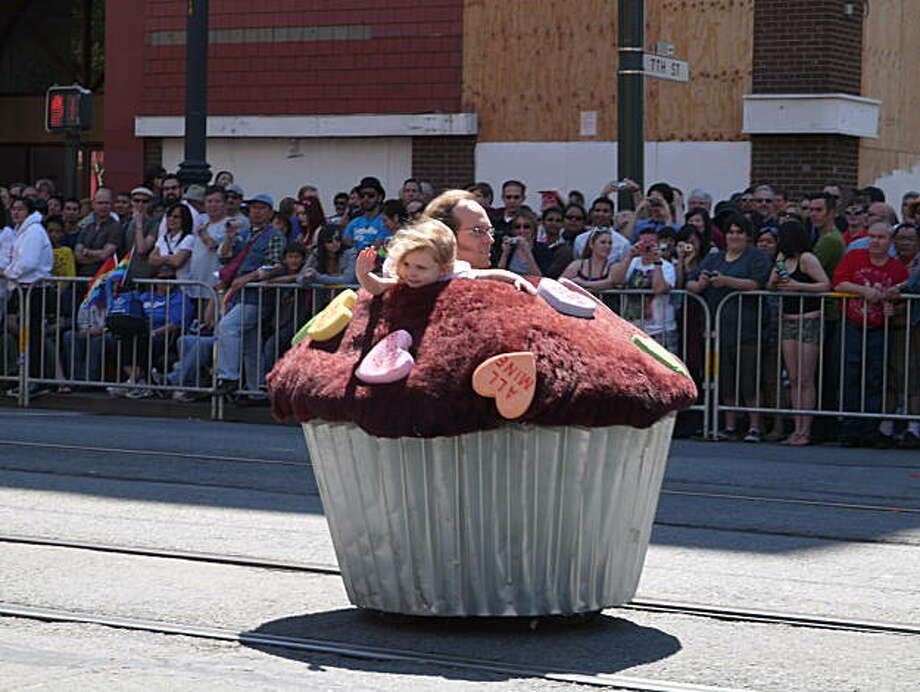 From inside this electric muffin covered in giant candy hearts, this little girl waves to the crowd of onlookers. Photo: Jeffkatz, Reader Photo