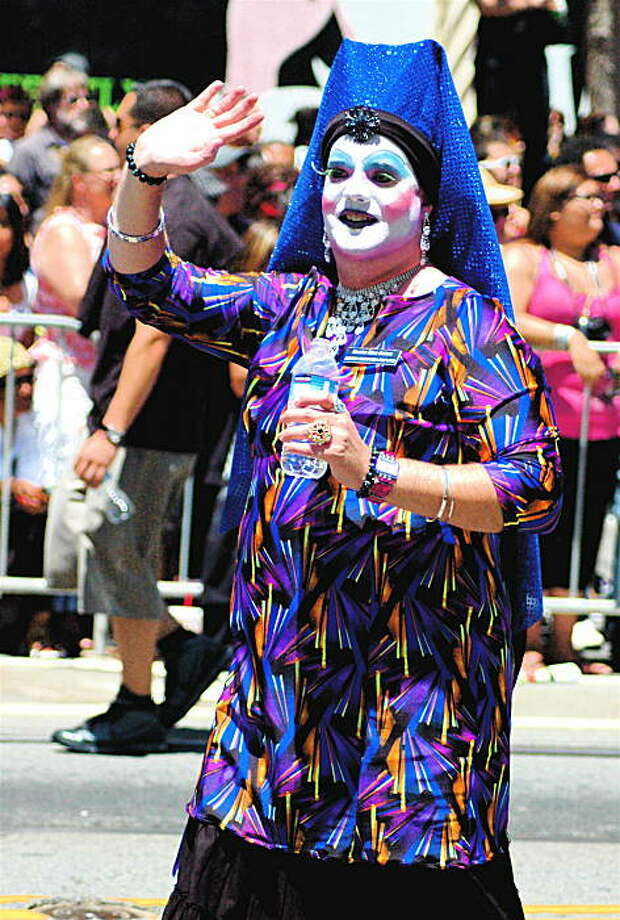 All decked out in costume to celebrate the 40th annual Gay Pride parade, this marcher waves to the crowd. Photo: Rsjaeger, Reader Photo