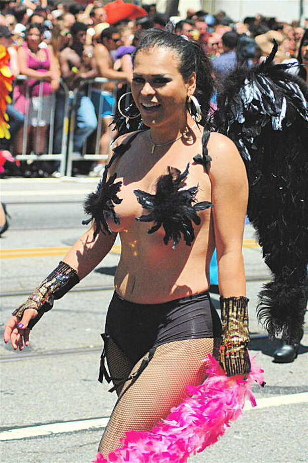 It is tradition at the San Francisco Gay Pride parade to bare it all, but many revelers, like this dark angel, use tactfully placed feathers or tape to remain family-friendly. Photo: Rsjaeger, Reader Photo