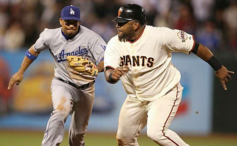 The Giants' Pablo Sandoval is caught in a run down in the seventh inning as Rafael Furcal applies the tag at AT&T Park on Monday in San Francisco. Photo: Jed Jacobsohn, Getty Images