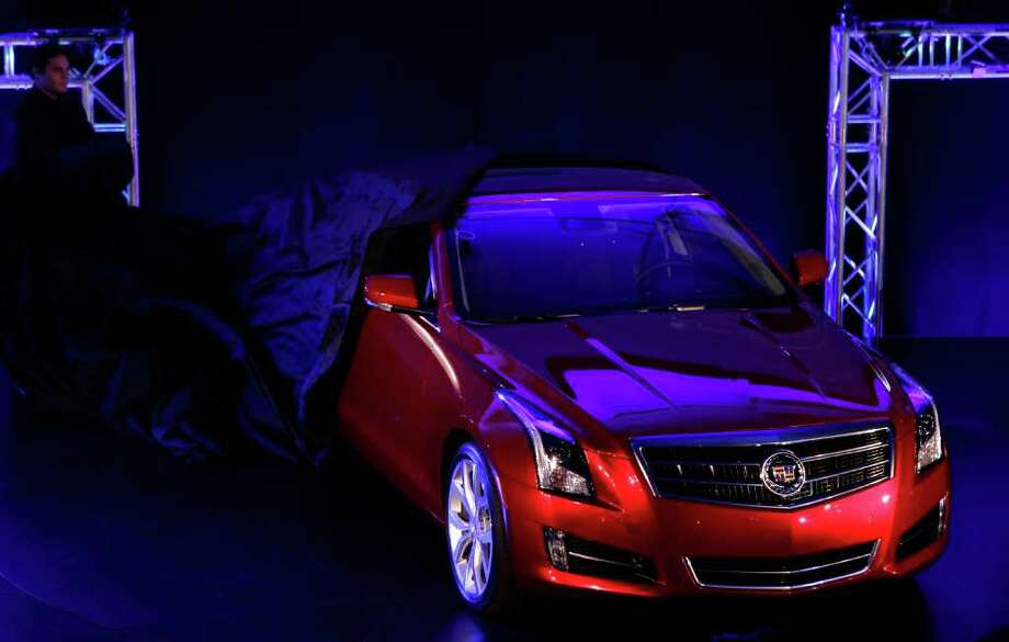 The 2013 Cadillac ATS is unveiled prior to the North American International Auto Show in Detroit, Sunday, Jan. 8, 2012. (AP Photo/Paul Sancya) Photo: Paul Sancya / AP