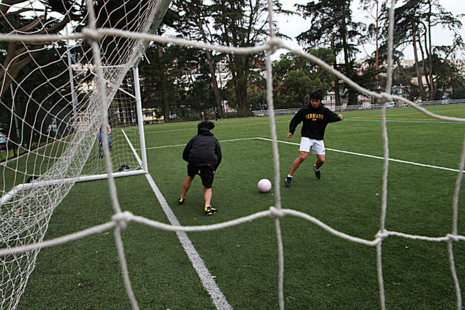 Brothers Dakota Yackel (left), 16 yrs. old, and Zack Yackel (right), 17 yrs. old, playing soccer on the artificial turf at Crocker Amazon park in San Francisco, Calif., on Tuesday, December 28, 2010.  A recent state study found that synthetic fields are actually safer than grass. Photo: Liz Hafalia, The Chronicle