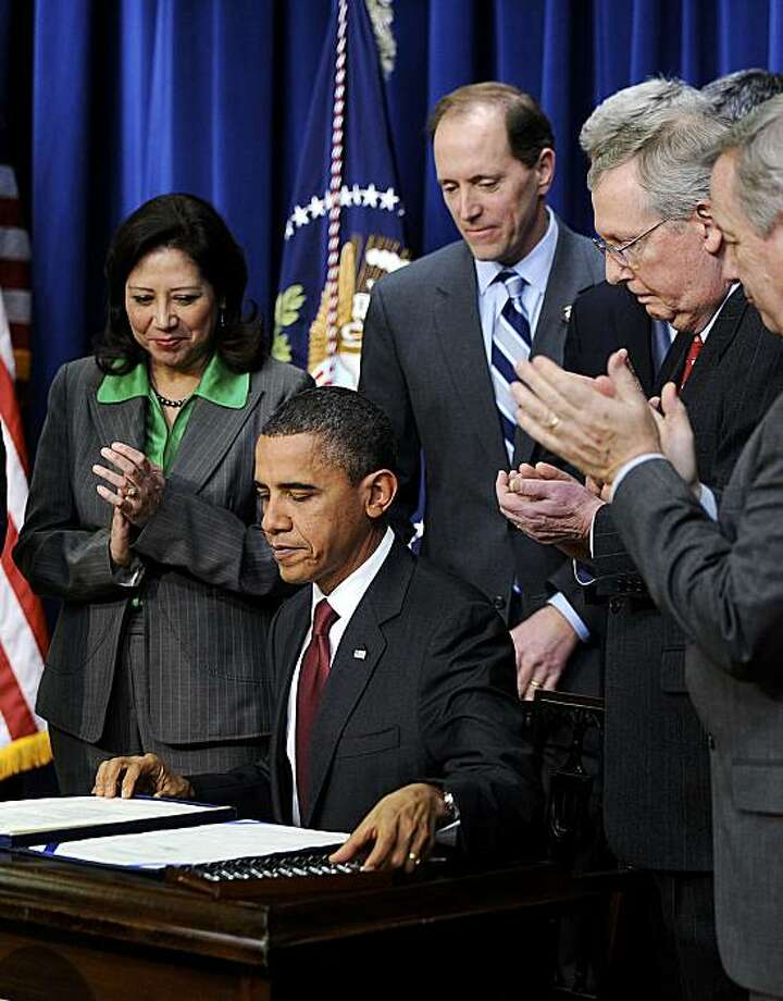 U.S. President Barack Obama signs into law an $858 billion bill extending for two years Bush-era tax cuts in the Eisenhower Executive Office Building in Washington, D.C., U.S., on Friday, Dec. 17, 2010. Obama overcame resistance from congressional Democrats and labor leaders to broker a tax-cut deal with Republicans, who'll take control of the House in January and gain Senate seats after last month's elections. Photographer: Olivier Douliery/Pool via Bloomberg *** Local Caption *** Barack Obama Photo: Olivier Douliery, Via Bloomberg