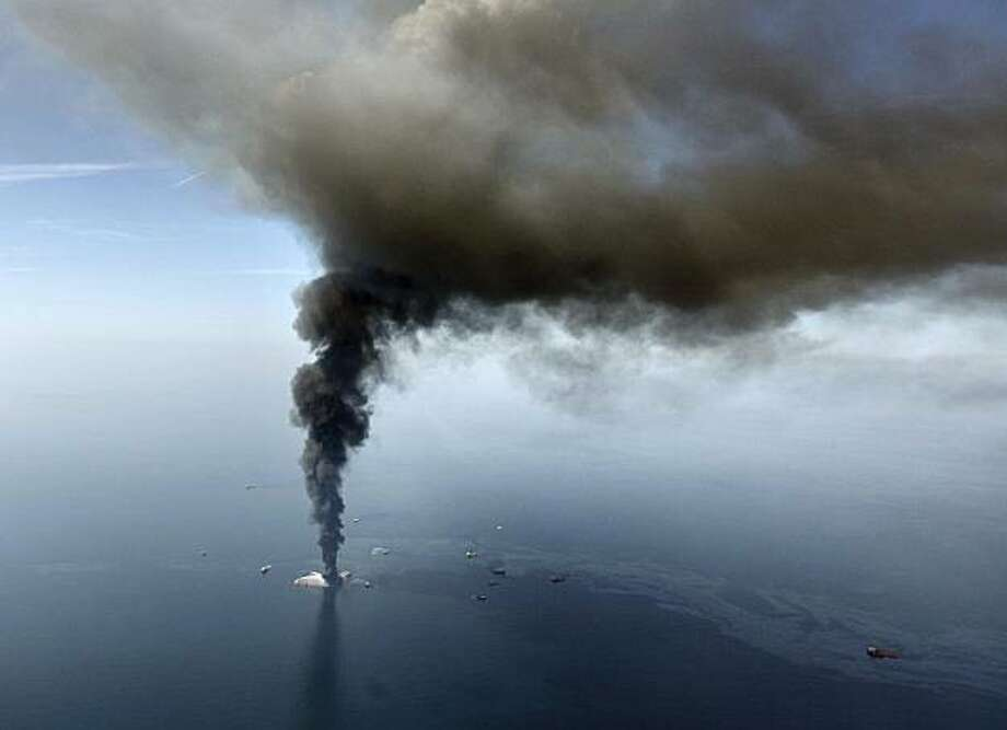 FILE - In this April 21, 2010, file photo, the Deepwater Horizon oil rig burns in the Gulf of Mexico. As the Gulf oil spill gushed out of control this summer, BP's financial liabilities expanded so rapidly that experts wondered if the company had drilledits last well. Only months later, though, the British oil giant has pulled itself back from the brink. Photo: Gerald Herbert, AP