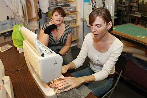 Kelly Williams teaches Regina Sinsky sewing basics at Craft Haven Collective. Photo: Scott Crosby