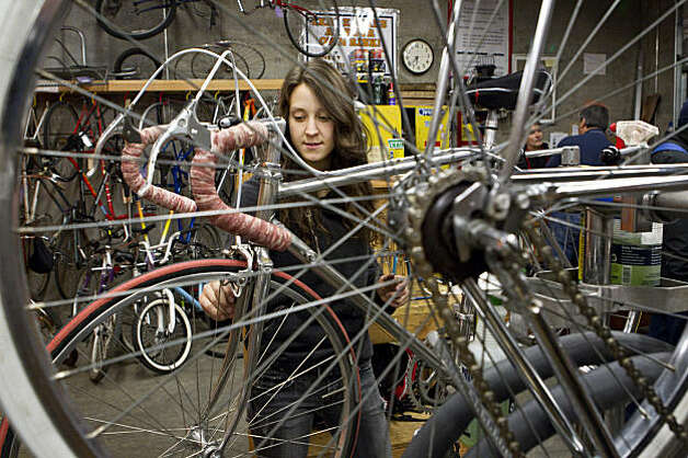 Stefunny Dettee works on fixing her bike at The Bike Kitchen in San Francisco, Calif., on Thursday, December 16, 2010.  The Bike Kitchen is a do-it-yourself resource for bikers that is run by volunteers. Photo: Laura Morton, Special To The Chronicle