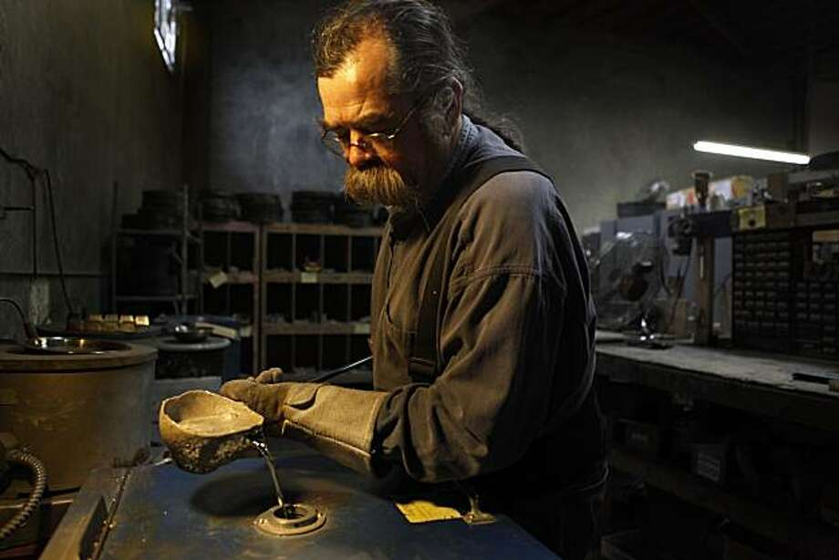 Wells Twombly pours molten pewter into a spin caster at the Fellowship Foundry on Wednesday Dec. 8, 2010 in Oakland, Calif.  In an era when most foundries have moved south to Mexico, Fellowship remains as one of the last California pewter producers. Photo: Mike Kepka, The Chronicle
