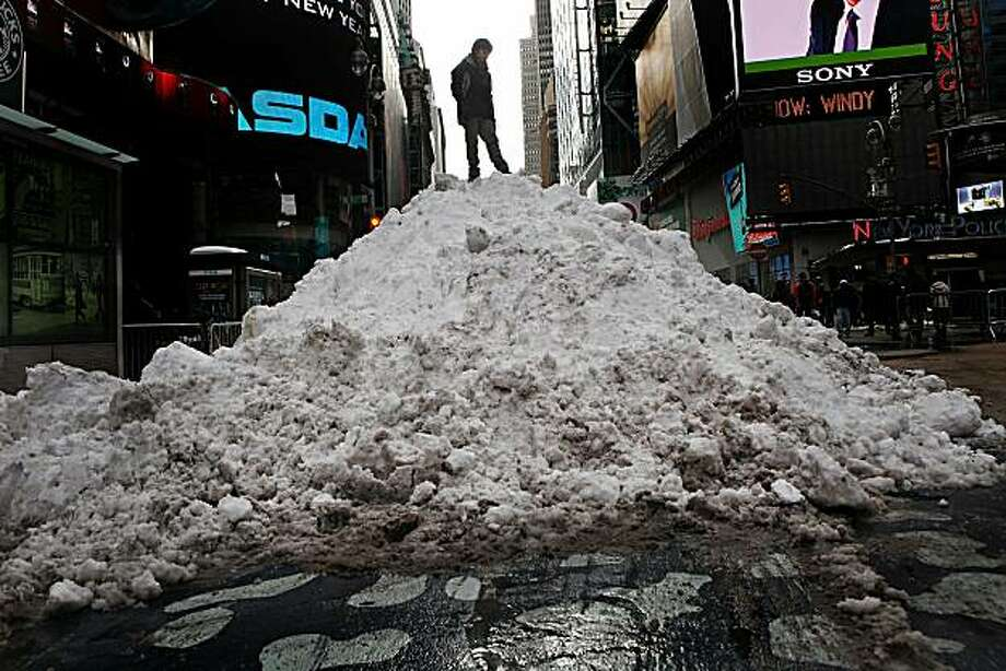 Martino Banella, age ten, stands on top of a mound of snow in Time Square during a vacation with his family from Italy on December 28, 2010 in New York City. Two days after a blizzard pounded the city some of the city's streets remain unclear. Photo: Andrew Burton, Getty Images