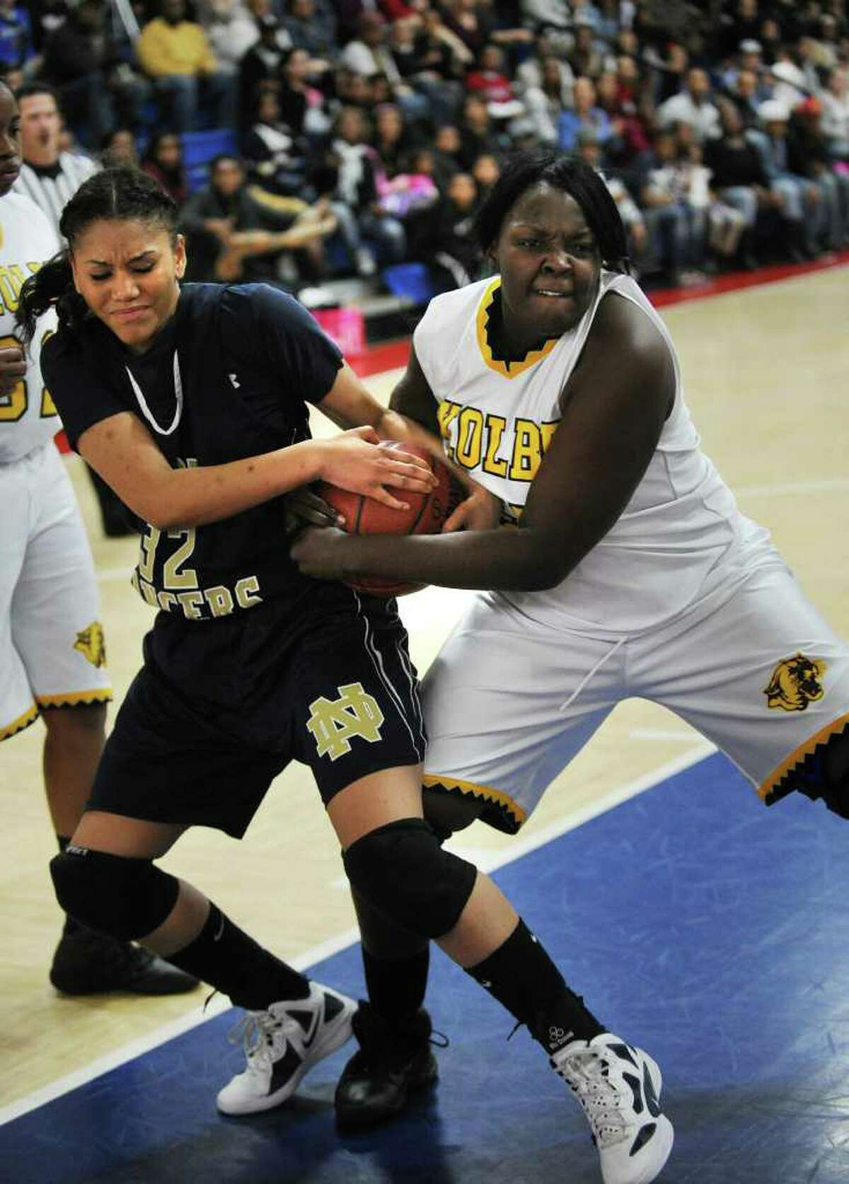 Notre Dame of Fairfield's Briana Mann, left, fights for a rebound with Kolbe Cathedral's Nini Green during their matchup at the Sheehan Center in Bridgeport on Monday, January 9, 2012.
