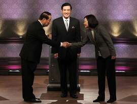 Presidential candidates, from right, Democratic Progressive Party's Tsai Ing-wen, Taiwan's President and ruling Nationalist Party's Ma Ying-jeou, and People First Party's James Soong, stand together before their presidential debate at Taiwan Public Television Service in Taipei, Taiwan, Saturday, Dec. 17. 2011. (AP Photo/Pei Chen, Pool)