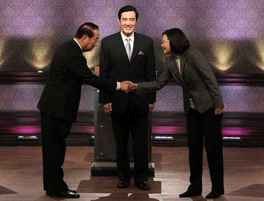 Presidential candidates, from right, Democratic Progressive Party's Tsai Ing-wen, Taiwan's President and ruling Nationalist Party's Ma Ying-jeou, and People First Party's James Soong, stand together before their presidential debate at Taiwan Public Television Service in Taipei, Taiwan, Saturday, Dec. 17. 2011. (AP Photo/Pei Chen, Pool) Photo: Pei Chen, Associated Press
