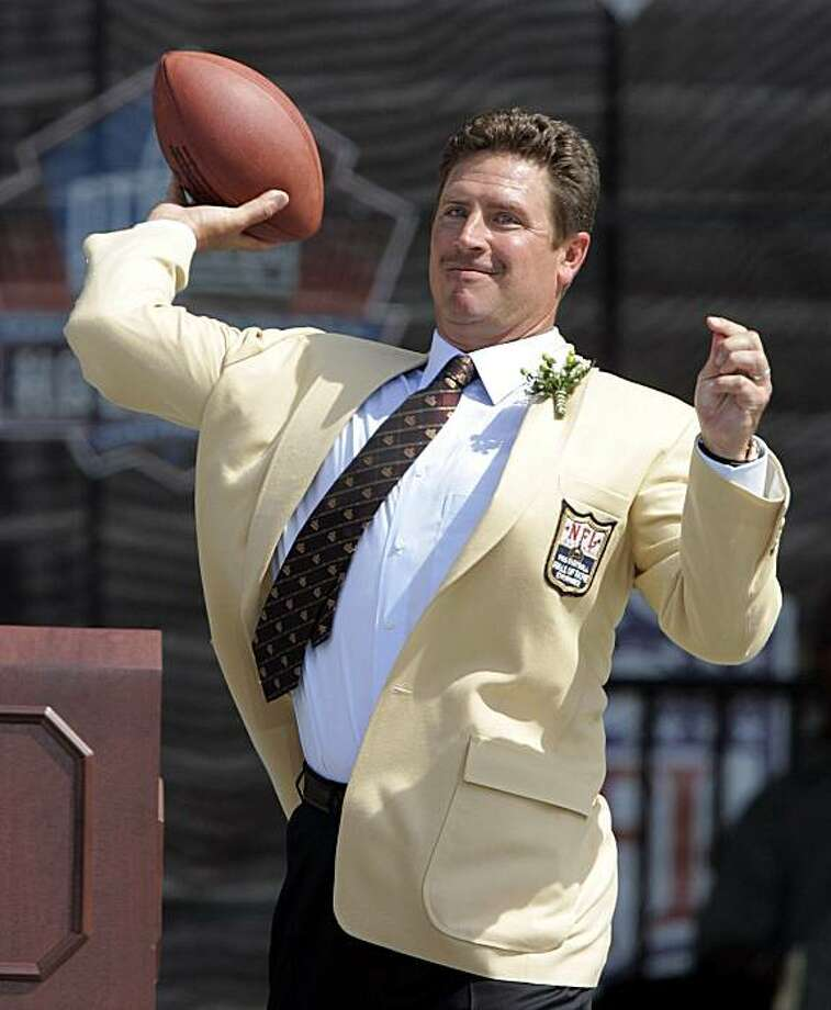 Former Miami Dolphins quarterback Dan Marino  throws a pass during a speech Sunday, Aug. 7, 2005 at the NFL Football Hall of Fame in Canton, Ohio. Star quarterbacks Dan Marino and Steve Young, along with NFL pioneers Benny Friedman and Fritz Pollard, were inducted into the Pro Football Hall of Fame. Photo: Tony Dejak, AP