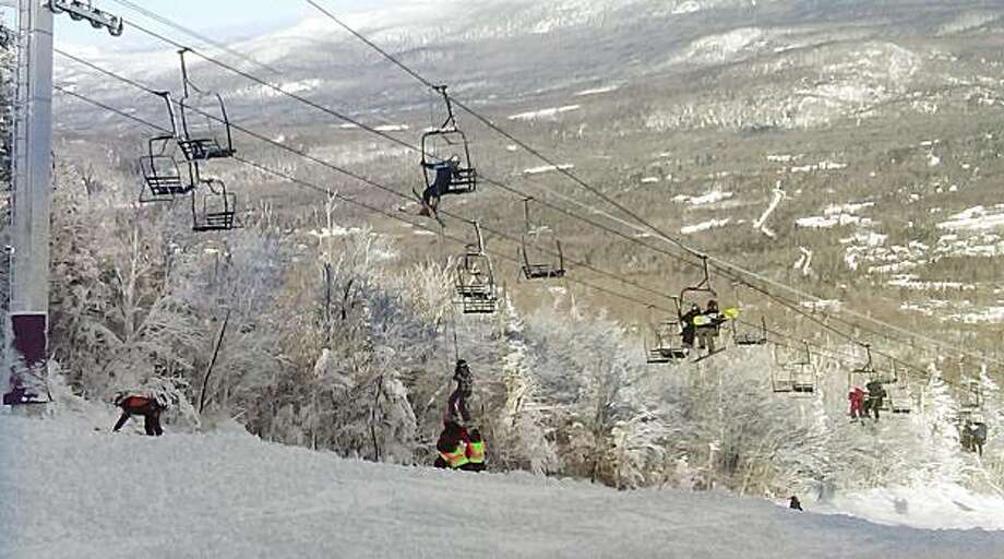 This photo provided by Betsy Twombly shows a skier being helped down from a lift chair, center, after a lift derailed on the state's tallest ski mountain at the Sugarloaf resort in Carrabassett Valley, Maine, Tuesday, Dec. 28, 2010. Photo: Betsy Twombly, AP