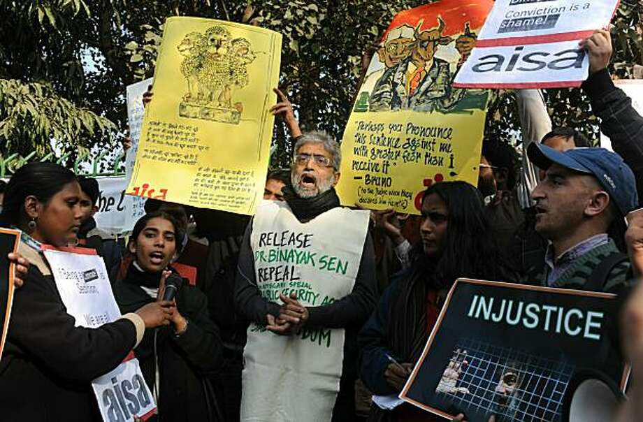 "Indian students, teachers, Women Association and political activists hold placards as they shout anti-government slogans in New Delhi on December 27, 2010 during a protest against life sentence handed out to a doctor and social activist, Binayak Sen, on charges of sedition in Chhattisgarh state. Amnesty International has described Binayak Sen as a ""prisoner of conscience"" but the court insisted the doctor helped outlawed Maoist guerrillas in the insurgency-riven state. Photo: Raveendran, AFP/Getty Images"