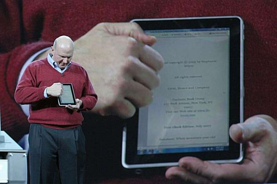 ** ADVANCE FOR USE TUESDAY, JAN. 12 AND THEREAFTER ** FILE - In this Jan. 6, 2010 file photo, Microsoft CEO Steve Ballmer delivers his keynote address at the 2010 Consumer Electronics Show where he showcased the new touch-enabled slate from HP. Ballmer showed off the new touch-screen, tablet-style computer from Hewlett-Packard Co., the first of several such devices expected to be unveiled this month. Speculation is growing that in two weeks Apple will unveil a tablet-style touch-screen computer that is bigger than an iPhone but smaller than a standard laptop. Photo: Dave Smith, AP