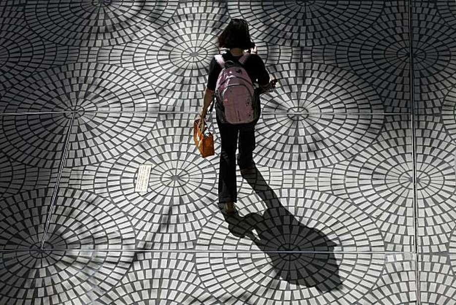 Shadows - 10:20 a.m. - San Francisco. While exploring San Francisco's Embarcadero Center 3,  I was drawn to the architecture and deep shadows. Camera Settings: EOS 5D Mark II. ISO 400, 1/800,  f/10, 105mm lens. Photo: Lance Iversen, The Chronicle