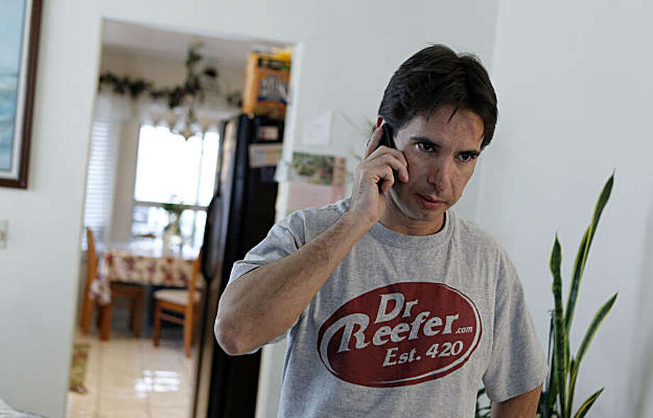 In this photo taken Thursday, Dec. 9, 2010, Pierre Werner answers a phone call concerning his business license which was revoked at his mother's home in Las Vegas. Werner's medical marijuana referral business was shut down by authorities. Photo: Isaac Brekken, AP