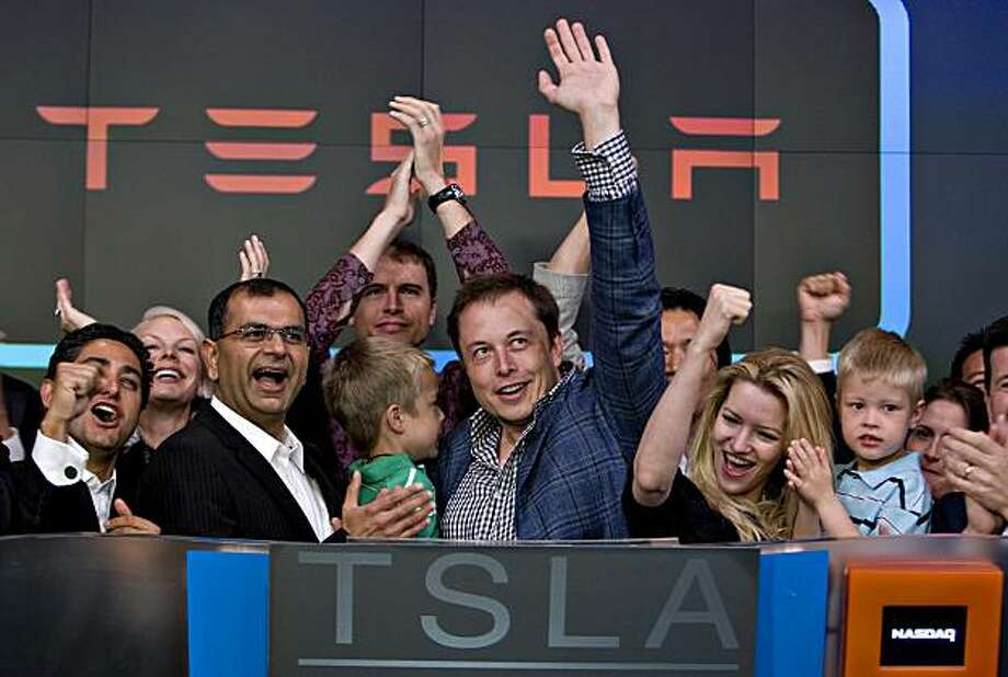 Elon Musk, chairman and chief executive officer of Tesla Motors, center, participates in the opening bell ceremony at the Nasdaq Marketsite with his twin boys Griffin, green shirt at center, and Xavier, right in blue shirt, and his fiancee Talulah Riley, second from right, in New York, U.S., on Tuesday, June 29, 2010. Tesla Motors Inc., the electric car company that hasn't posted a profit, raised $226 million selling shares above its forecast price range in the first initial public offering of a U.S. automaker in a half century. Photographer: Daniel Acker/Bloomberg *** Local Caption *** Elon Musk; Xavier Musk; Griffin Musk; Talulah Riley Photo: Daniel Acker, Bloomberg