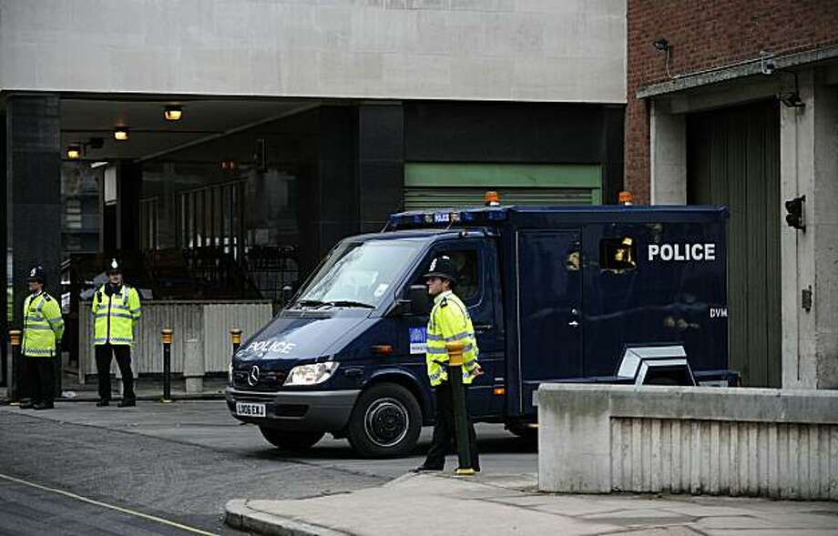 "A police prison van carrying men arrested on charges relating to alleged attacks leaves Westminster Magistrates Court in central London on December 27, 2010. Nine men were remanded in custody charged with plotting to cause explosions in Britain and otherterror offences, a week after they were arrested in pre-dawn raids. The men appeared at City of Westminster Magistrates Court on charges of conspiracy to cause explosions ""of a nature likely to endanger life or cause serious injury to property"" between October 1 and November 20 this year. Photo: Carl Court, AFP/Getty Images"