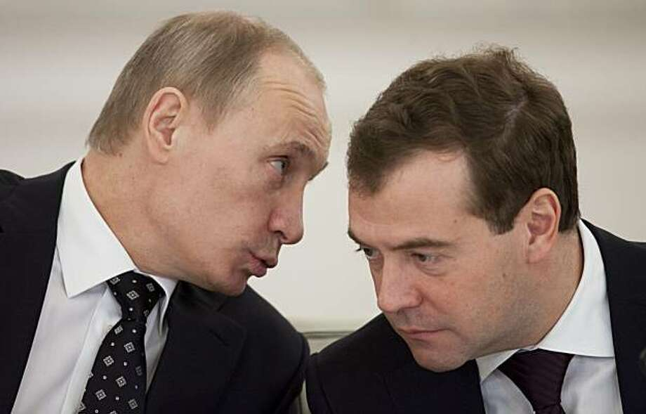 Russian President Dmitry Medvedev and Prime Minister Vladimir Putin, left, speak during a meeting with regional governors  in Moscow,  Russia, Monday, Dec. 27, 2010. Russia's President Dmitry Medvedev says that ethnic tensions are threatening Russia's stability. Photo: Alexander Zemlianichenko, AP