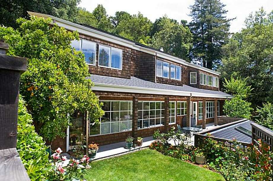 Located on a landscaped lot, 11 Poplar Drive in Kentfield was built in 1988 and includes four bedrooms and two and a half bathrooms. At 3,042 square feet, it's listed for $1.875 million. Photo: Robert Vente Photography