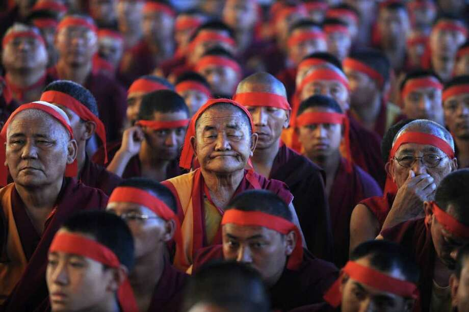 Buddhist monks attend the prayer session of Tibetan Spiritual Leader The Dalai Lama during the 'Kalachakra Initiaton' on the Ninth day of the Kalachakra Festival in Bodhgaya on January 9, 2012. Kalachakra 2012, a festival of teachings and meditations will take place from January 1, 2012 for ten days in the northern Indian state of Bihar and will be attended by Tibetan Spiritual Leader The Dalai Lama. Photo: DIPTENDU DUTTA, AFP/Getty Images / AFP