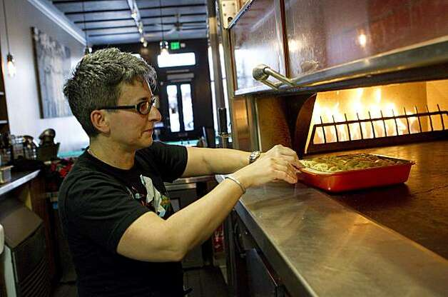 Sharon Ardiana puts her baked rigatoni dish in the oven at Ragazza in San Francisco, Calif., on Thursday, December 16, 2010. Photo: Laura Morton, Special To The Chronicle