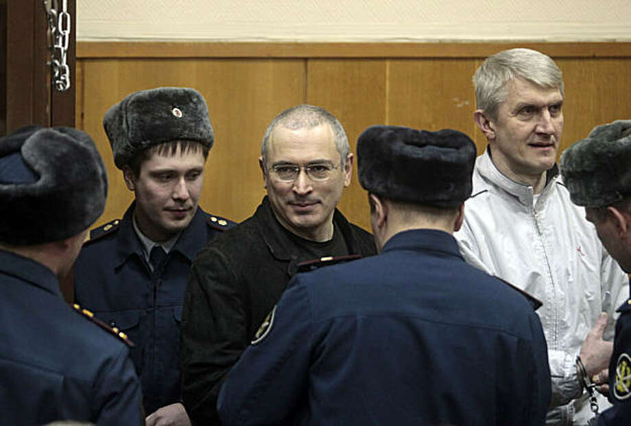 Mikhail Khodorkovsky, center, and his co-defendant Platon Lebedev, right, are escorted to a court room in Moscow, Russia, Monday, Dec. 27, 2010. The judge on Monday declared former oil tycoon Mikhail Khodorkovsky guilty of theft and money laundering charges in his second trial, Russian news agencies reported, a verdict that would likely keep Russia's once richest man behind bars for several more years. Photo: Sergey Ponomarev, AP