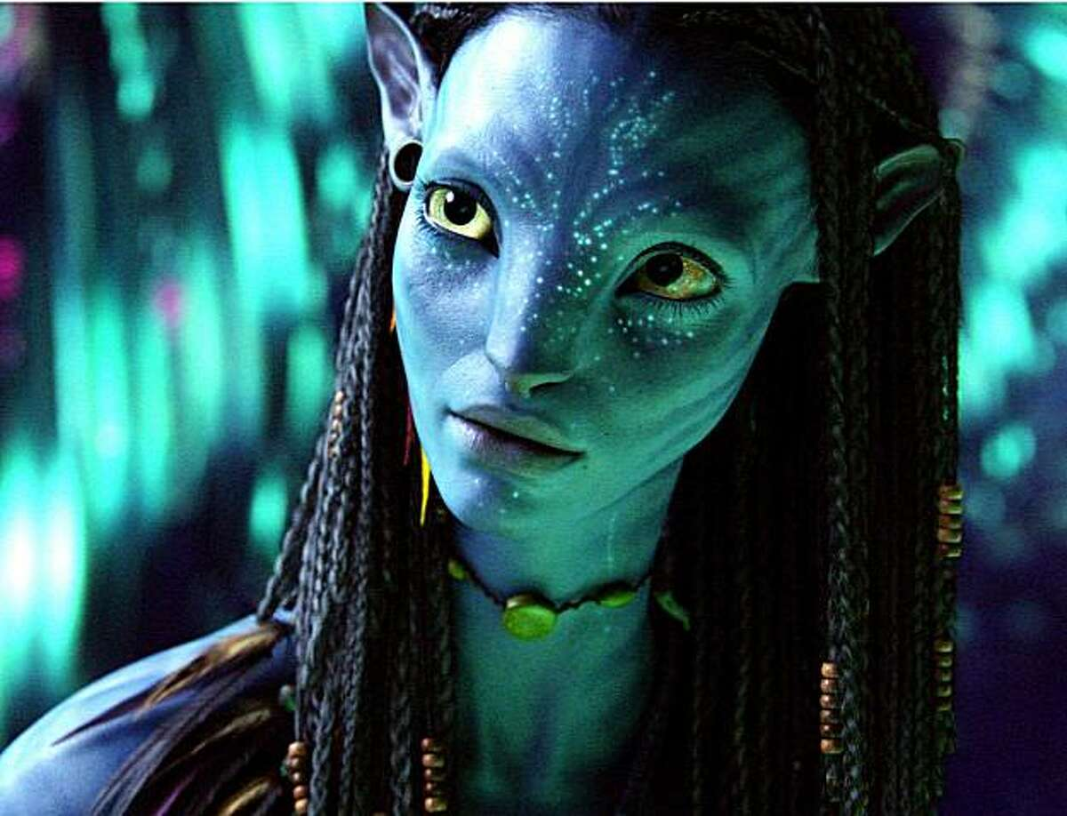 """In this film publicity image released by 20th Century Fox, the character Neytiri, voiced by Zoe Saldana, is shown in a scene from, """"Avatar."""" (AP Photo/20th Century Fox)"""