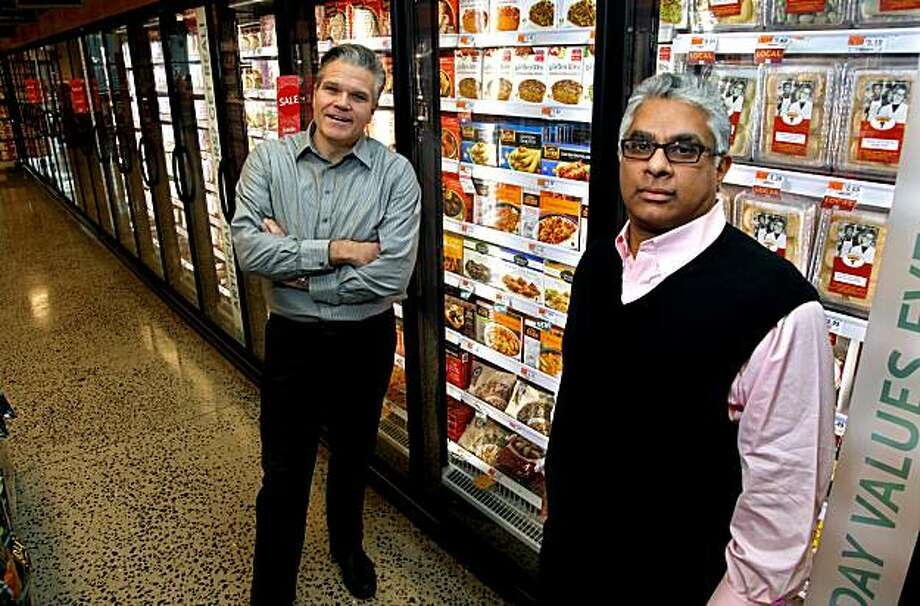 In this Dec. 14, 2010 photo, Jack Acree, executive vice president with American Halal Co., Inc., left, and Adnan Durrani, Chief Halal Officer with American Halal Co., Inc, stand near their products in a freezer case at a Whole Foods store in Darien, Conn. The company helped Whole Foods develop its first nationally distributed halal (Islamically permitted) food product called Saffron Road entrees that the food stores started selling in August. Photo: Craig Ruttle, AP